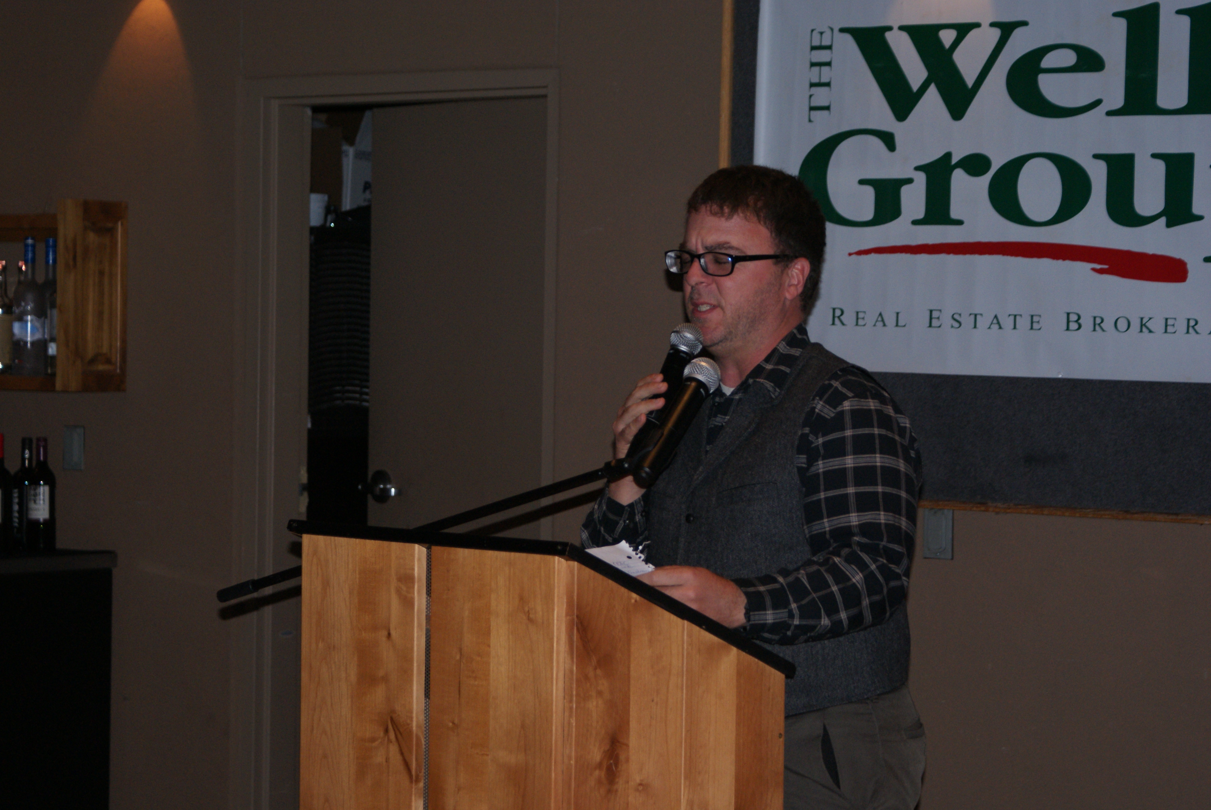 Jerome Bleger presents the Realtor of the Year Award.